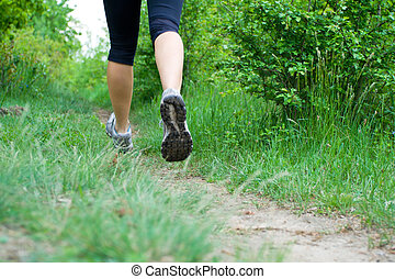 Woman cross country running on trail - Legs on cross country...