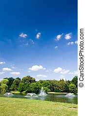 City park with fountains - Summer in park with pond and...