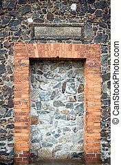 Stone wall with doors of medieval church - Wall clogged...