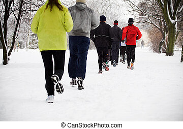 People running in winter park, motion blur - People running...