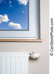 Radiator and blue sky in home interior