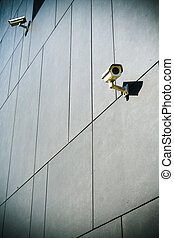 Security cameras on dark building - Dark building with...