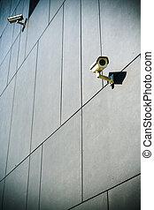 Security cameras on dark building - Dark building with...