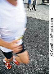 Man running in city marathon