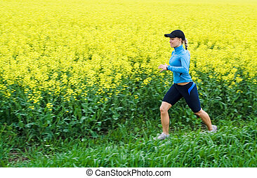 Young woman running outdoors