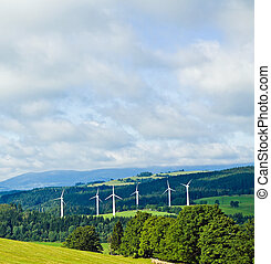 Wind turbines in mountains - Wind turbines in summer green...