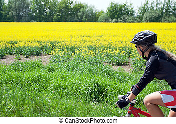 Woman riding bicycle on a summer day