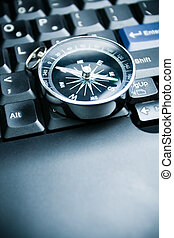 Business decision - Computer keyboard and retro compass,...