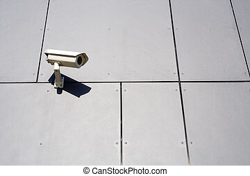 Modern building and security camera - Security camera on...