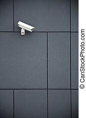 Security camera on dark modern building