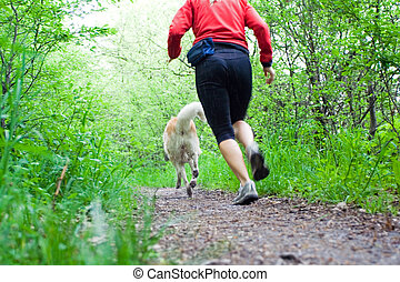 Running in forest with dog