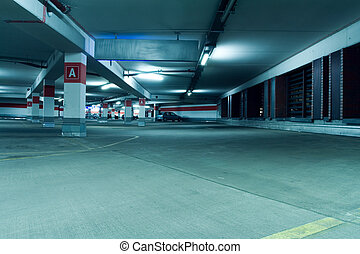 Underground parking garage interior - Parking garage of...