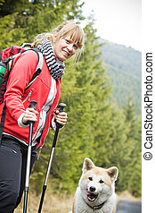 Nordic Walking with dog - Nordic Walking in Autumn mountains...