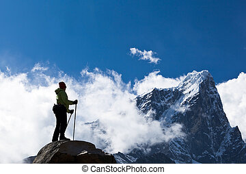 Woman hiking in Himalaya Mountains - Young woman hiker...