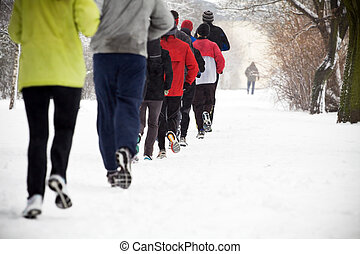 People running in winter park - People running in park on...