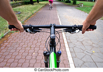 Commuting on bicycle path - Bicycle path rider, motion blur