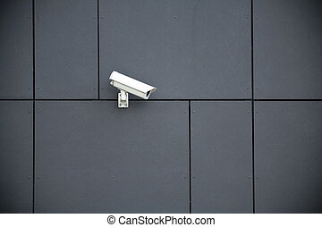Security camera on dark modern building
