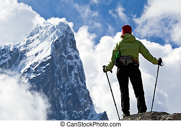Woman hiking in mountains - Young woman hiker hiking in...