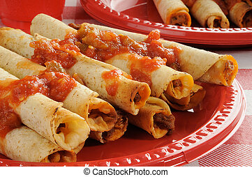 Rolled up tacos - beef and cheese taquitos or rolled up...
