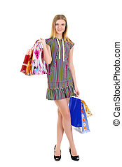 Girl with bags after shopping smiling