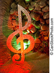 treble clef - glowing treble clef in the cave
