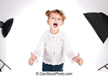girl giving thumbs up with studio flash