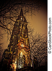 old church with branches at night