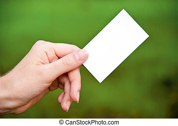 empty card in a hand on a green background