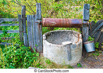 old well in garden with fence
