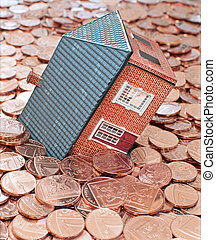 Mortgage debt - Small house buried in coins