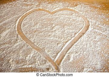 Heart - Symbol heart farded in flour on baking