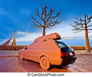 Ice Covered Car - Car with frozen ice at Lake Geneva during...