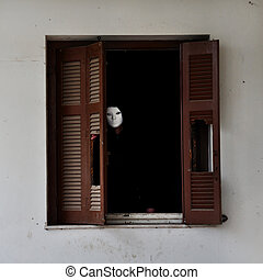 masked figure and broken window shutter - Man with white...
