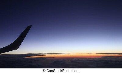 Flight And Sunset