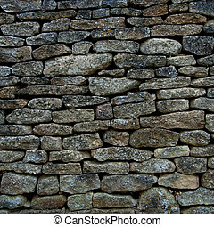 Old stone wall - Old and weathered stone wall background,...