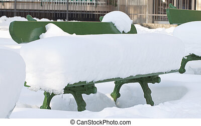 Bench - A city bench completely full of snow