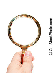 magnifying glass in a hand isolated on a white background