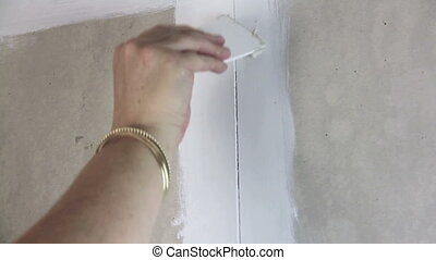 Filling Gaps 1 - Filling the gaps in a wall with putty or...