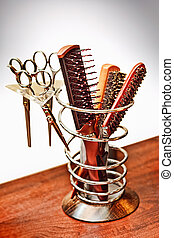 A set of scissors and combs - A set of combs and scissors...