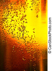 Glass of beer with bubbles - Detail glass of beer with...