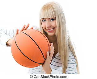 cheerful girl throwing a basketball ball - cheerful young...