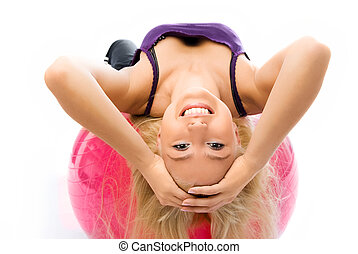 beautiful woman works out on the fitness ball - beautiful...