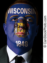 High key portrait of a serious businessman or politician whose face is painted in american state of west wisconsin flag
