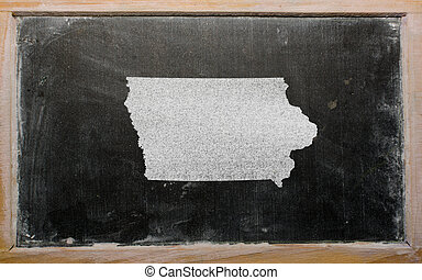 outline map of us state of iowa on blackboard