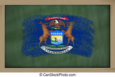 flag of us state of michigan on blackboard painted with chalk