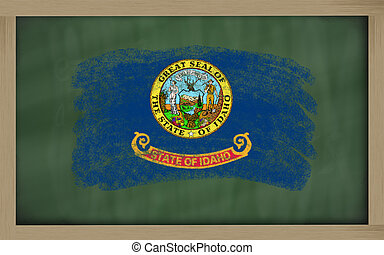 flag of us state of idaho on blackboard painted with chalk
