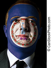 High key portrait of a serious businessman or politician whose face is painted in american state of virginia flag