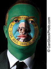 High key portrait of a serious businessman or politician whose face is painted in american state of washington flag