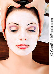 close eyes - Portrait of a woman with spa mask on her face....