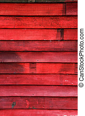 Old wood wall and chipping red color